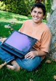 Student met zijn nieuwe laptop van het aanrakingsstootkussen Stock Foto
