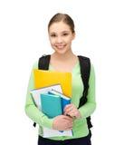 Student mit Büchern und Schultasche Stockbild