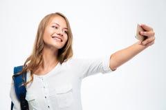 Student mit dem Rucksack, der selfie Foto macht Stockfoto