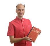 Student mit Lehrbuch Englisch Lizenzfreie Stockfotografie