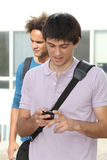 Student with mobile phone Royalty Free Stock Photos