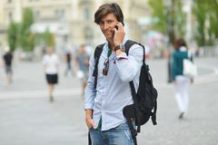 Student with the mobile smart phone walking Stock Photo