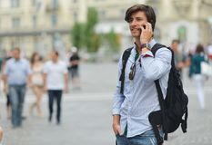 Student with the mobile smart phone walking Royalty Free Stock Images