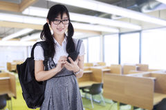 Student with mobilephone in class Stock Photos