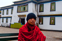 Student Monk. A Buddhist student is sitting on a bench in the lobby at Rumtek Monastery, Sikkim, India Royalty Free Stock Image