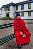 Student Monk. A Buddhist student is sitting on a bench in the lobby at Rumtek Monastery, Sikkim, India Royalty Free Stock Images