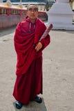 Student Monk at Do Drul Chorten Stupa. A Buddhist monk holding a copy of Buddhist manuscript in hand at Do Drul Chorten Stupa at Sikkim, India Stock Photo