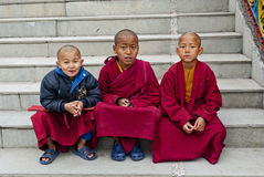 Student Monk. Three children Buddhist students with their manuscript at Ralang Monastery, Sikkim, India Royalty Free Stock Photography