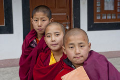 Student Monk. Three children Buddhist students with their manuscript at Ralang Monastery, Sikkim, India Royalty Free Stock Images