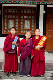 Student Monk. Three children Buddhist students with their manuscript at Ralang Monastery, Sikkim, India Stock Photography