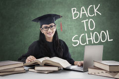 Student with mortarboard back to school and studying Stock Photography