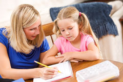 Student: Mother Showing Girl How To Complete Problem Stock Image