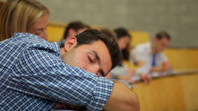 Student napping in the lecture hall stock video footage