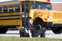 Student near the school bus Stock Image