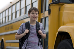 Student near the school bus Royalty Free Stock Photos
