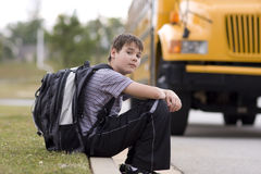 Student near the school bus Royalty Free Stock Photography