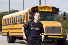Free Student Near The School Bus Stock Image - 5229851
