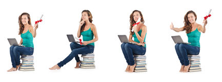 The student with netbook sitting on books Stock Photos