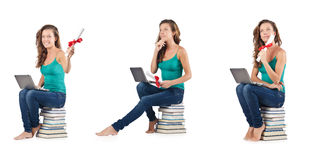 The student with netbook sitting on books Stock Photo