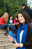 Student with Notebook. Asian Student with notepad on campus Stock Images