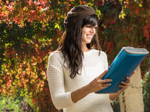 Student and notebook in autumn Stock Photos