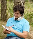 Student with notebook and headphones. Stock Images