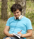 Student with notebook and headphones. Royalty Free Stock Images