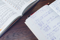 Textbook and student notebook for algebra on the table. Student notebook and textbook for algebra on the table stock image