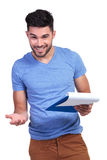 Student with notepad inviting you to learn Royalty Free Stock Photo