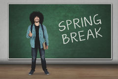 Student with ok sign and spring break word Stock Photos