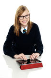 Student operating new touch screen tablet device Royalty Free Stock Images