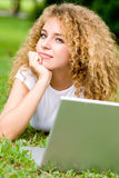 Student Outside. An attractive female student working on laptop in the park royalty free stock image