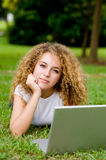 Student Outside. An attractive female student working on laptop in the park stock images