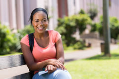 Student outside campus. Happy african american college student outside campus Royalty Free Stock Photo