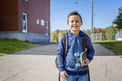 Student outside school standing smiling Stock Photos