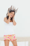 Student in pajama listing to music while jumping Stock Photos