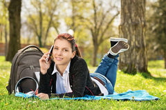 Student in a park talking on the phone stock image