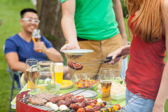 Student party. Smiling students during summer party in garden Royalty Free Stock Photography