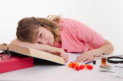 Student pharmacist pretended to be asleep in class Stock Photos