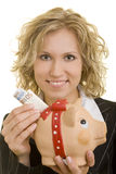 Student with piggy bank. Blonde business woman holding a big piggy bank with European paper currency Stock Images