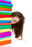 Student and pile of books Stock Images