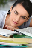 Student with pile of books. Female student with a pile of books Stock Image