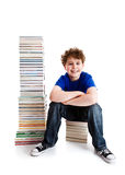 Student and pile of books Stock Photo