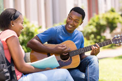 Student playing guitar girlfriend Royalty Free Stock Photo