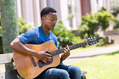 Student playing guitar Royalty Free Stock Image
