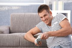 Student playing video game at home Stock Photo
