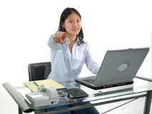 Student pointin. A female student at her pointing isolated over white stock photography