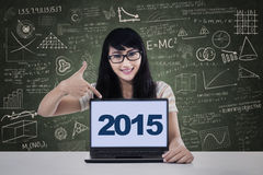 Student pointing numbers 2015 on laptop Royalty Free Stock Photos