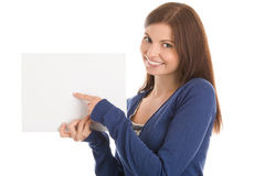 Student pointing at sheet with white copy space Royalty Free Stock Photo