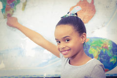 Student pointing to a map of the world Royalty Free Stock Image
